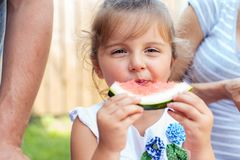 Candid portrait of a girl eating watermelon Stock Photos