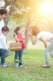 Grandmother, mother and children. Candid portrait of happy multi generations Asian family at nature park. Grandmother, mother and children outdoor fun. Morning Stock Image
