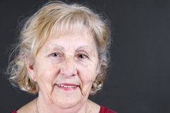 Candid portrait of senior woman. Candid portrait of real person, a smiling senior citizen or old woman, no retouching great details stock image