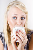 Candid portrait of woman enjoying hot beverage Stock Photos