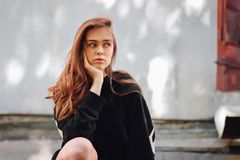 Candid portrait of young beautiful long hair girl fashion model hipster on city street. Candid portrait of young beautiful long hair girl fashion model hipster royalty free stock photography