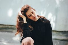 Candid portrait of young beautiful long hair girl fashion model hipster on city street. Candid portrait of young beautiful long hair girl fashion model hipster royalty free stock photos