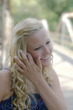 A beautiful blonde high school senior. A female senior portrait shoot smiles at the camera during a summer shoot in Iowa brick door blue iowa blonde person royalty free stock image