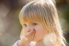 Candid serious thinking or sad young baby caucasian blonde girl portrait outdoor Royalty Free Stock Images
