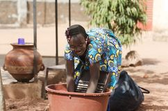 Candid Shot of African Black Ethnicity Girl Child Labour. Candid Shot of African children in Bamako, Mali. By buying this image you support our local charity Stock Photos