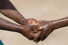 Water Issues in Africa - Black Children Washing Hands Royalty Free Stock Photos