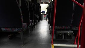 Candid shot between seats of passengers sitting inside bus while traveling.  stock video