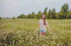 Candid skipping carefree adorable woman in field Stock Photography
