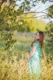 Candid skipping carefree adorable woman in field Royalty Free Stock Image