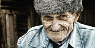 Candid smile of one adorable wise senior man stock photography