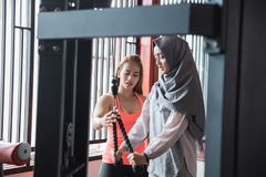 Candid view of young asian muslim woman hijab exercising triceps stock photo
