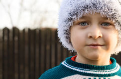 Candid winter portrait of cute kid Royalty Free Stock Photos