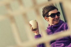 Candid Woman Outdoors with Coffee stock images