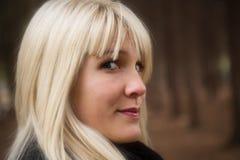 Candid woman portrait. Candid blond woman portrait, outdoor shot, selective focus royalty free stock images