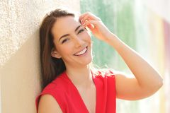 Candid woman in red with perfect smile looking at camera stock photos