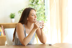 Candid woman thinking at home Stock Image