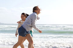 Candid women laughing at the beach Stock Photo