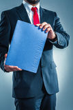 Candidate with application folder. Candidate is holding a blue application folder Royalty Free Stock Photos