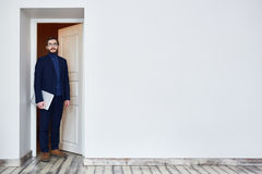 Candidate Coming for Job Interview. Man in glasses standing in doorway and looking at camera coming into office for job interview Stock Photos