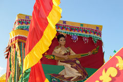 Candidate-on-float. MANILA, PHILIPPINES - APR. 14: pageant contestant in her cultural dress pauses during Aliwan Fiesta, which is the biggest annual national Royalty Free Stock Photography
