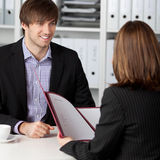 Candidate Looking At Businesswoman Taking Interview royalty free stock images
