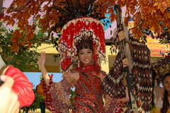 Candidate waving her hand. MANILA, PHILIPPINES - APR. 14: pageant contestant in her cultural dress pauses during Aliwan Fiesta, which is the biggest annual Royalty Free Stock Image