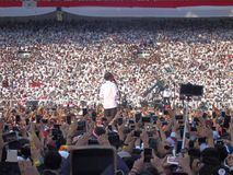Candidates for President Joko Widodo campaign in front of hundreds of thousands of supporters at GBK Senayan. stock photo
