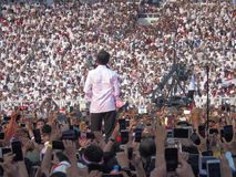 Candidates for President Joko Widodo campaign in front of hundreds of thousands of supporters at GBK Senayan. royalty free stock photo