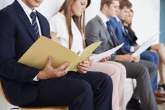 Candidates waiting for job interviews, mid section stock image