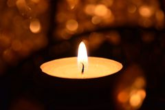Candie. Burning candle in the night Royalty Free Stock Image
