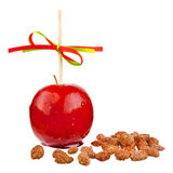 Candied apple with almonds Stock Images