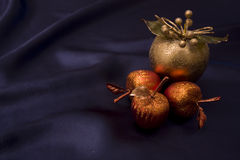 Candied apples. On a blue silk background Stock Images
