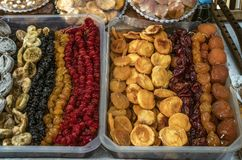 Candied apricots, peaches, figs,prunes, yellow and red cherries in plastic trays. Exhibited in plastic trays candied apricots, peaches, figs,prunes, yellow and royalty free stock photography