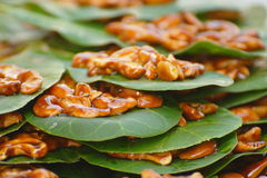 Candied Cashew Nuts on a Leaf. Candied Cashew Nuts on Leaves at a local market in Chaweng, Koh Samui, Thailand royalty free stock photos