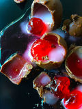 Candied cherries in chocolate shells Stock Photo
