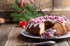 Candied cranberries bundt cake with lemon sugar glaze Royalty Free Stock Images