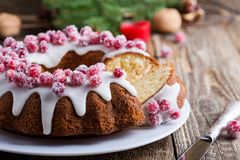 Candied cranberries bundt cake with lemon sugar glaze Stock Photography
