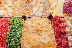 Candied different fruits in stores.  Royalty Free Stock Image