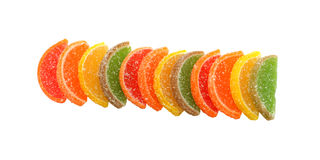 Candied fruit. Candied orange slices stacked in a line. Isolated object Royalty Free Stock Images