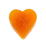 Candied fruit jelly apricot in the form of heart on isolated background Stock Photo