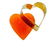 Candied fruit jelly apricot in the form of heart on isolated background with iron form Stock Images