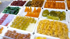 Candied fruit presented on showcase beckoning customers, appetizing sweets. Stock photo stock photo