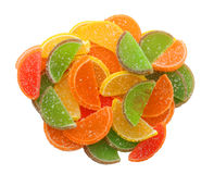 Candied fruit slices in a heap. Multi-colored candied fruit slices in a heap. Isolated object Royalty Free Stock Photos