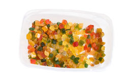 Candied Fruits. Food & Drinks - Ingredients. Plastic container with pieces of candied fruits Royalty Free Stock Image