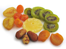 Candied fruits. (kiwi, pineapple, pears, dates) on white background Royalty Free Stock Photo