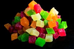 Candied fruits on a black background royalty free stock photography
