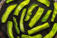 Candied fruits from a bright green pomelo on the grill from above Royalty Free Stock Photos