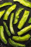 Candied fruits from a bright green pomelo on a grill close-up Royalty Free Stock Images