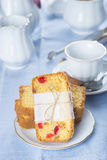 Candied fruits cake with tea and coffee for breakfast Royalty Free Stock Photo