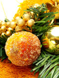 Candied fruits, golden ornaments as Christmas deco Stock Image